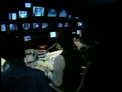 broadcast tv; england: london: lime grove: bbc studios: int bv control room - bericht film und fernsehen stock-videos und b-roll-filmmaterial