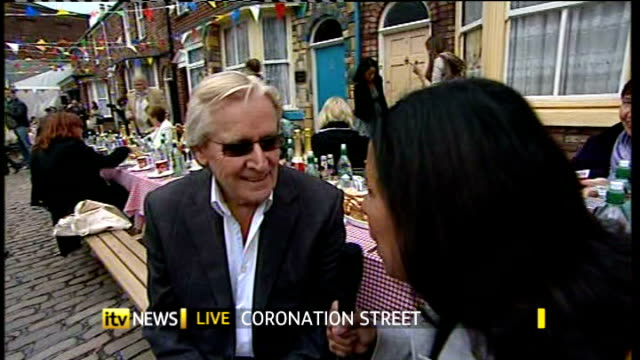 50th anniversary of coronation street england manchester ext reporter to camera sot william roache interview sot talks of the plans for the episodes... - ウィリアム・ローチ点の映像素材/bロール
