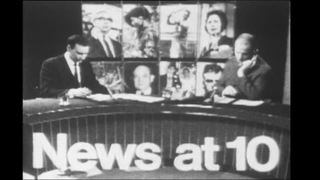 60th anniversary of itv and itn excerpt opening titles of an early news at ten bulletin / various newsreaders in studio / sir trevor mcdonald... - itv news at ten stock-videos und b-roll-filmmaterial