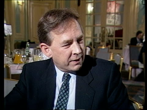 broadcasting breakfast; england: london: savoy hotel: int gv broadcasters seated at tables in dining room as waiters to 7 fro sir robin day seated as... - robin day stock videos & royalty-free footage