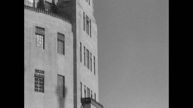 montage broadcasting house facade and statue detailing / london, england, united kingdom - 1937 stock-videos und b-roll-filmmaterial