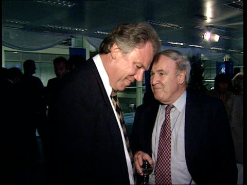 itn 40th anniversary reception john suchet and other guests / puvis and itn newsreader julia somerville / peter sissons with tait and others in the... - judith chalmers stock videos & royalty-free footage