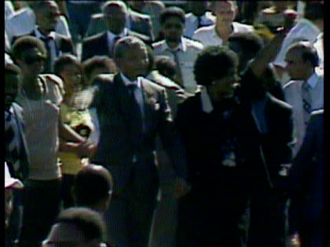 40th anniversary; itn south africa: ext seq release of nelson mandela - releasing stock videos & royalty-free footage