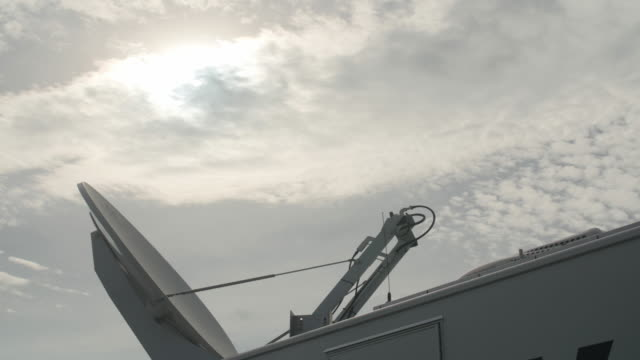 tv broadcasting satellite transmission truck - satellite tv stock videos and b-roll footage