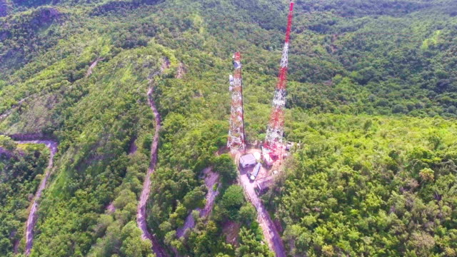 tv broadcasting tower on green mountain with drone, aerial view - repeater tower stock videos and b-roll footage