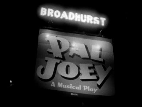 broadhurst theatre marquee 'pal joey a musical play' various people attendees standing outside theater on west 44th street nyc theatre district the... - broadway manhattan video stock e b–roll