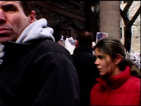 vídeos y material grabado en eventos de stock de broadway at fulton street- lower manhattan- winter- people walk past impromptu street memorials near ground zero. american flag hangs on railings.... - luto