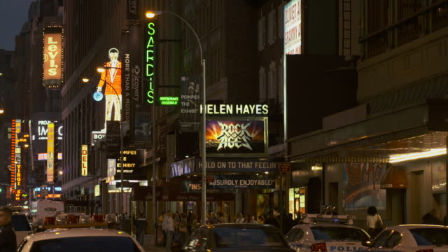 broadway at night including sardis, bowlmore lanes, the discovery museum and rock of ages - broadway manhattan stock videos & royalty-free footage