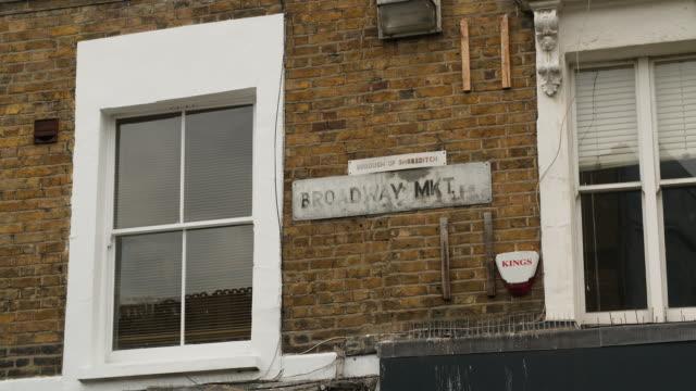 broadway market street sign, east london - brick stock videos & royalty-free footage