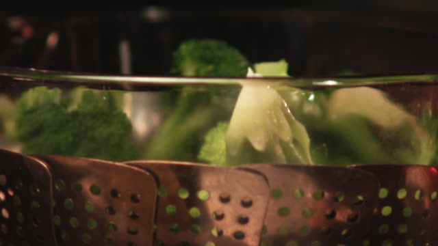 SLO MO, ECU, TU, TD, Broccoli being placed in steamer on stove