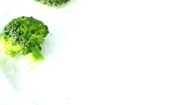 broccoli falling in to water splashing in slow motion , 250 FPS
