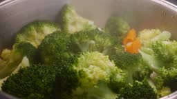 Broccoli florets very green green healthy and ready to cook with carrot and cauliflower balnca mega healthy.