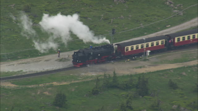 brocken tv tower and steam train - peak tower stock videos and b-roll footage
