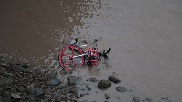 broken bicycle for public hire inside the river - moored stock videos & royalty-free footage