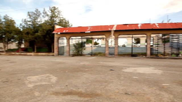 ws pan broken building/ ciudad juárez/ mexico - security bar stock videos and b-roll footage