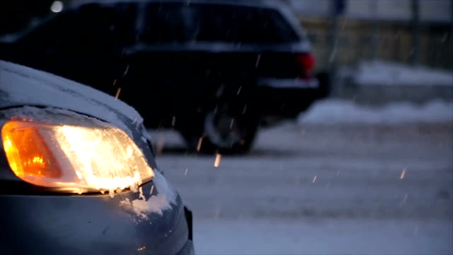 Broken car on a snowy winter road