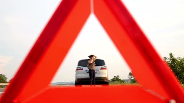 broken car,calling for help - roadside stock videos & royalty-free footage