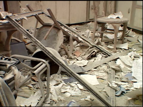 stockvideo's en b-roll-footage met broken chairs, stools on floor, broken picture frame with drawing of girl covered in dust at liberty st. apartment near ground zero after the... - september 11 2001 attacks