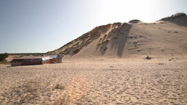 broken down by time and weather and covered in graffitti bits of german bunkers scatter the dune de pilat the dune is the tallest sand dune in europe... - buch stock videos & royalty-free footage