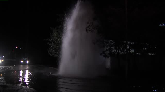 ktxl broken fire hydrant floods streets in antelope on april 16 2015 - fire hydrant stock videos & royalty-free footage