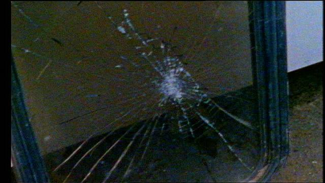 broken glass on large window in miami florida - mirror stock videos & royalty-free footage