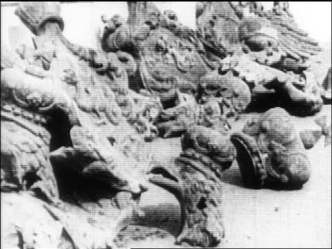 b/w 1918 broken masonry emblems of czar's rule lying on ground / russia / documentary - 1918 stock videos and b-roll footage