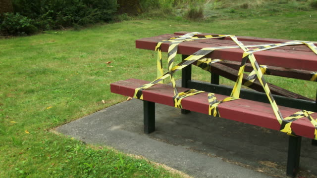 Broken Picnic Table Covered in Caution Tape