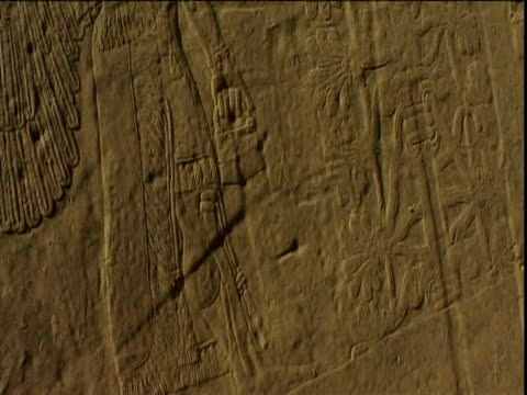 broken segments of walls bearing mythological engravings and ziggurat in ancient assyrian city of nimrud iraq - irak stock-videos und b-roll-filmmaterial
