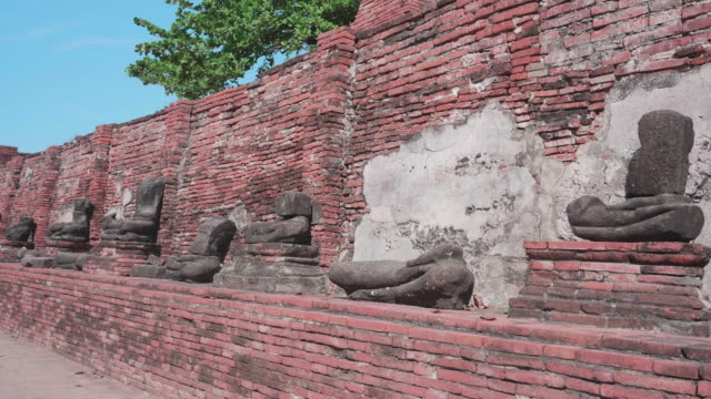 broken statue in wat mahathat in ayutthaya, thailand - mayan stock videos & royalty-free footage