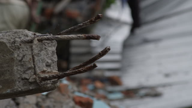 stockvideo's en b-roll-footage met barabise, nepal - july 31, 2015: cu broken steel bars - groot