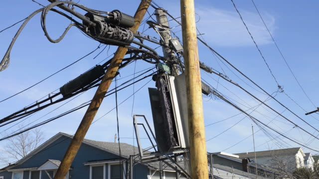 broken telegraph pole with wires hanging down - telegraph pole stock videos and b-roll footage