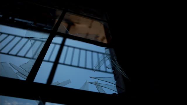 a broken window frames racing clouds. - broken stock videos & royalty-free footage