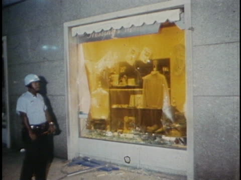 broken window shows the damages caused by the riots during the 1968 democratic national convention. - 1968 stock videos & royalty-free footage