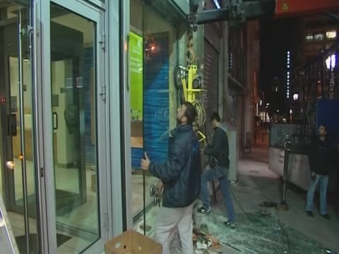 broken windows of a shop are being replaced after protests in greece against austerity measures - ユーロ圏債務危機点の映像素材/bロール