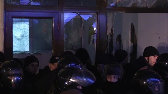 Broken windows of the bank Sberbank of Russia after protest of Ukrainian activists after their rally to the third anniversary of the Euromaidan...