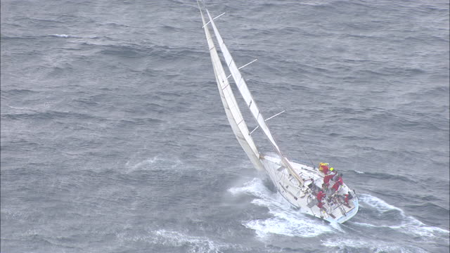brokenwood in choppy conditions: the 54ft yacht sailed by sailors with disabilities in the 2009 sydney to hobart yacht race. skippered by david pescud, australia - rough stock videos & royalty-free footage