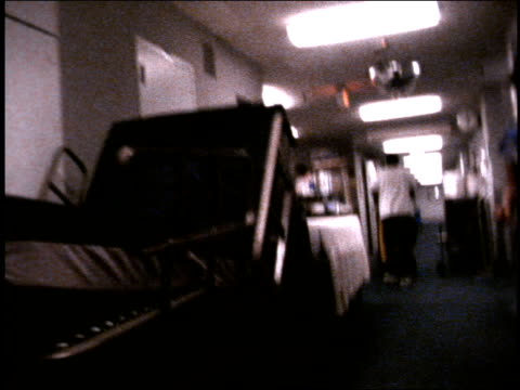 broll footage camera moving through a hospital shot on film - krankenhaus rollbett stock-videos und b-roll-filmmaterial
