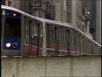 roll footage of a chicago l train in motion. camera zooms out. - chicago 'l' stock videos & royalty-free footage