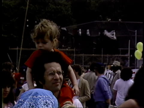 roll footage of a father and daughter during a 1982 rally against nuclear arms in central park. - political rally stock videos & royalty-free footage