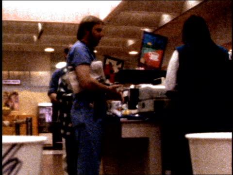 vídeos de stock e filmes b-roll de broll footage of a hospital cafeteria shot on film circa early1980's - bata cirúrgica