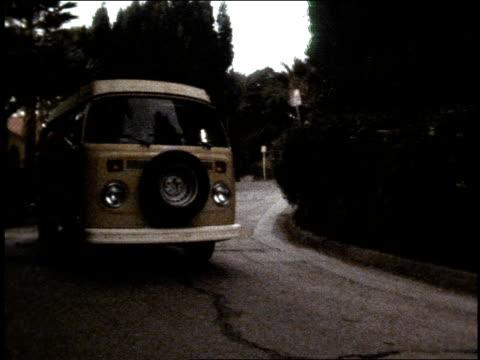 broll footage of an old vw van driving down the street - van stock videos & royalty-free footage