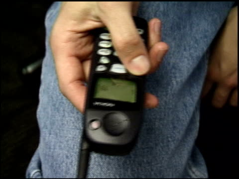 roll footage of dialing numbers on an old nokia cell phone. circa late 1990's. - 1990 1999 stock videos & royalty-free footage