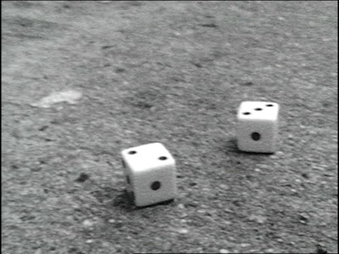 BRoll footage of dice rolling on pavement Super 8mm film
