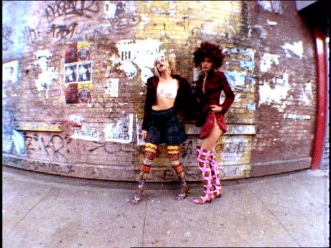 broll footage of fashion models walking by and posing in front of a brick wall in nyc 1994 shot on film - mtv点の映像素材/bロール