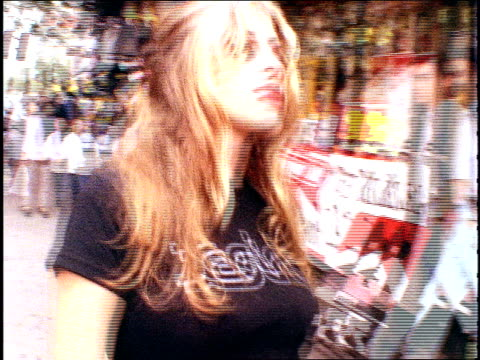 stockvideo's en b-roll-footage met roll footage of models acting out a scene of flirting on the street in the east village nyc, 1994. - b roll