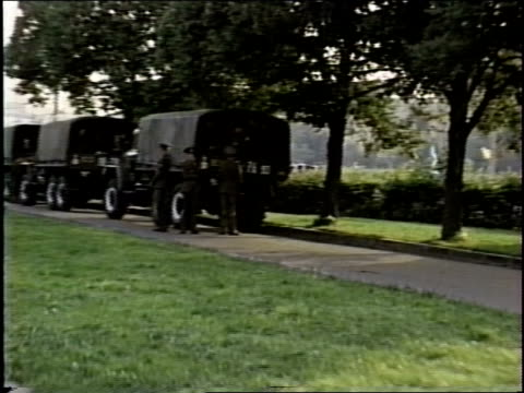 Broll footage of Soviet military trucks and soldiers in a Leningrad park circa late 1980's