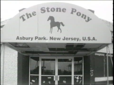 BRoll footage of The Stone Pony exterior and equipment being loaded inside Super 8mm black and white film