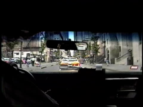 roll from backseat of taxi driving through midtown - back seat stock videos and b-roll footage