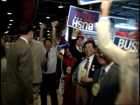 vídeos de stock e filmes b-roll de roll from the 1992 rnc crowd holding bush, quayle and kemp signs. - 1992