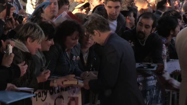 Gary Oldman signs for fans at the UK Premiere of Tinker Tailor Soldier Spy BRoll Gary Oldman signs for fans at BFI Southbank on September 13 2011 in...